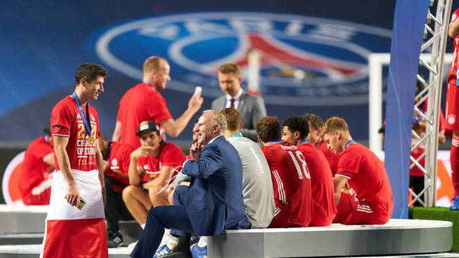 Bayern boss Karl-Heinz Rummenigge joins the players after winning the Champions League