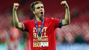LONDON, ENGLAND - MAY 25:  Philipp Lahm of Bayern Muenchen celebrates after winning the UEFA Champions League final match against Borussia Dortmund at Wembley Stadium on May 25, 2013 in London, United Kingdom.  (Photo by Alex Grimm/Getty Images)