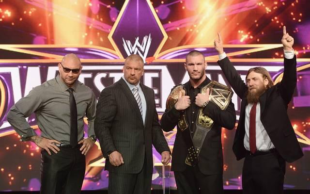 Batista (l.) und Triple H (2.v.l., mit Randy Orton und Daniel Bryan) waren bei WWE Partner und Rivalen
