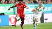 AUGSBURG, GERMANY - OCTOBER 19: Serge Gnabry of FC Bayern Munich runs with the ball past Philipp Max of FC Augsburg during the Bundesliga match between FC Augsburg and FC Bayern Muenchen at WWK-Arena on October 19, 2019 in Augsburg, Germany. (Photo by Alexander Hassenstein/Bongarts/Getty Images)