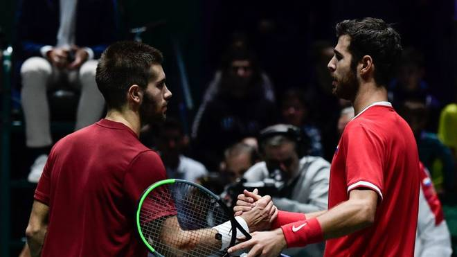 Russia's Karen Khachanov (R) and Croatia's Borna Coric shake hands after their singles tennis match between Croatia and Russia at the Davis Cup Madrid Finals 2019 in Madrid on November 18, 2019. (Photo by JAVIER SORIANO / AFP) (Photo by JAVIER SORIANO/AFP via Getty Images)