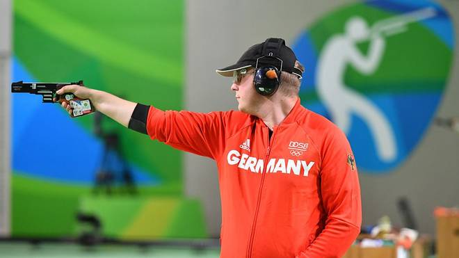 Gold medal winner Germany's Christian Reitz competes during the 25m Rapid Fire Pistol men's final at the Olympic Shooting Centre in Rio de Janeiro on August 13, 2016, during the Rio 2016 Olympic Games. / AFP / PASCAL GUYOT        (Photo credit should read PASCAL GUYOT/AFP/Getty Images)