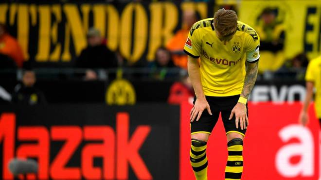 Dortmund's German forward Marco Reus stands on the field during the German first division Bundesliga football match between Borussia Dortmund and VfL Wolfsburg on November 2, 2019 in Dortmund, western Germany. (Photo by INA FASSBENDER / AFP) / DFL REGULATIONS PROHIBIT ANY USE OF PHOTOGRAPHS AS IMAGE SEQUENCES AND/OR QUASI-VIDEO (Photo by INA FASSBENDER/AFP via Getty Images)