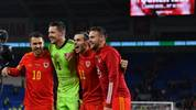 Wales' players celebrate victory and qualification after the Group E Euro 2020 football qualification match between Wales and HUngary at Cardiff City Stadium in Cardiff, Wales on November 19, 2019. - Wales beat Hungary 2-0 to qualify. (Photo by Paul ELLIS / AFP) (Photo by PAUL ELLIS/AFP via Getty Images)