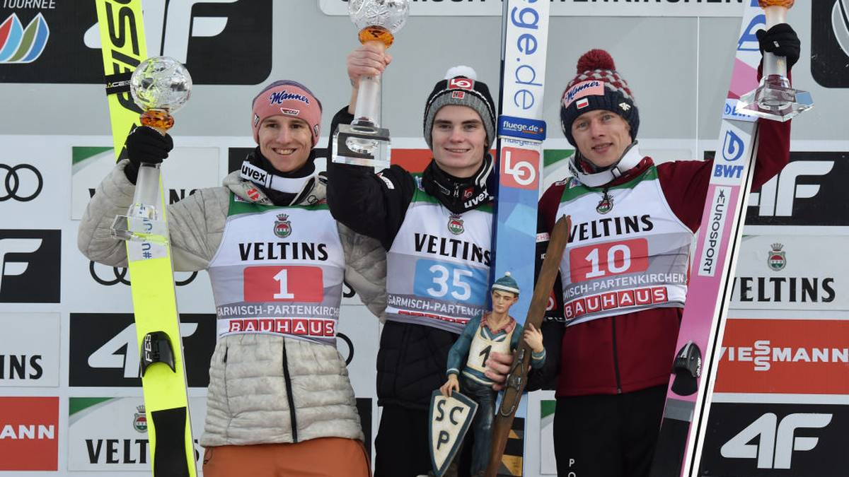 (L-R) Second-placed Karl Geiger of Germany, winner Marius Lindvik of Norway and third-placed Dawid Kubacki of Poland pose on the podium afer the Four-Hills Ski Jumping tournament (Vierschanzentournee) in Garmisch-Partenkirchen, southern Germany, on January 1, 2020. (Photo by Christof STACHE / AFP) (Photo by CHRISTOF STACHE/AFP via Getty Images)