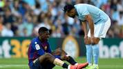 Celta Vigo's Moroccan midfielder Sofiane Boufal (R) checks on Barcelona's French forward Ousmane Dembele after resulting injured during the Spanish league football match between RC Celta de Vigo and FC Barcelona at the Balaidos stadium in Vigo on May 4, 2019. (Photo by Miguel RIOPA / AFP) / The erroneous byline appearing in the metadata of this photo by MIGUEL RIOPA has been modified in AFP systems in the following manner: [Miguel Riopa] instead of [Oscar Pozo]. Please immediately remove the erroneous mention[s] from all your online services and delete it (them) from your servers. If you have been authorized by AFP to distribute it (them) to third parties, please ensure that the same actions are carried out by them. Failure to promptly comply with these instructions will entail liability on your part for any continued or post notification usage. Therefore we thank you very much for all your attention and prompt action. We are sorry for the inconvenience this notification may cause and remain at your disposal for any further information you may require.        (Photo credit should read MIGUEL RIOPA/AFP via Getty Images)
