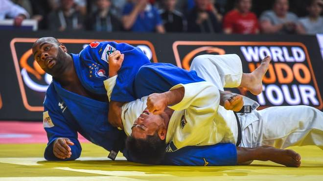 TOPSHOT - France's Teddy Riner (L) fights against Japan's Kokoro Kageura during the over 100 kg category men's third round fight at the Judo Paris Grand Slam 2020, in Paris, France. (Photo by Lucas Barioulet / AFP) (Photo by LUCAS BARIOULET/AFP via Getty Images)