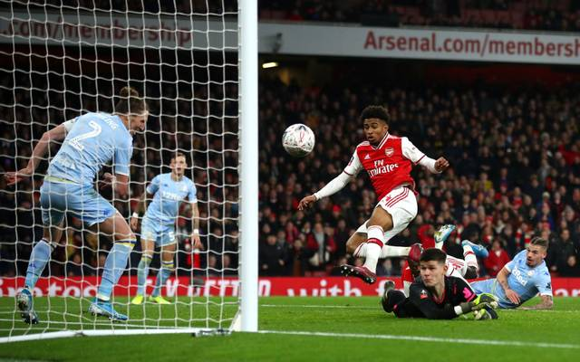LONDON, ENGLAND - JANUARY 06:  Reiss Nelson of Arsenal scores his side's first goal during the FA Cup Third Round match between Arsenal FC and Leeds United at the Emirates Stadium on January 06, 2020 in London, England. (Photo by Julian Finney/Getty Images)
