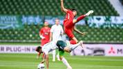 Bremen's Finnish defender Niklas Moisander (L) and Heidenheim's German forward Denis Thomalla vie for the ball during the German Bundesliga relegation first-leg football match Werder Bremen v 1 FC Heidenheim 1846 on July 2, 2020 in Bremen, northern Germany. (Photo by Carmen JASPERSEN / various sources / AFP) / DFL REGULATIONS PROHIBIT ANY USE OF PHOTOGRAPHS AS IMAGE SEQUENCES AND/OR QUASI-VIDEO (Photo by CARMEN JASPERSEN/AFP via Getty Images)