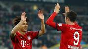 MOENCHENGLADBACH, GERMANY - MARCH 02: Robert Lewandowski of Bayern Munich celebrates after scoring his team's fifth goal with Jeong Woo-Yeong of Bayern Munich during the Bundesliga match between Borussia Moenchengladbach and FC Bayern Muenchen at Borussia-Park on March 02, 2019 in Moenchengladbach, Germany. (Photo by Maja Hitij/Bongarts/Getty Images)