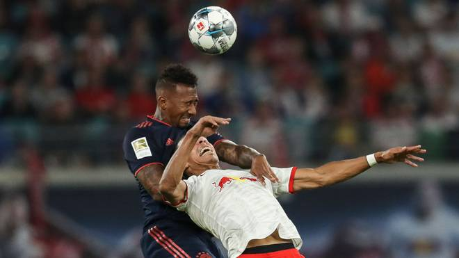 LEIPZIG, GERMANY - SEPTEMBER 14: Jerome Boateng of Bayern Munich and Yussuf Poulsen of RB Leipzig battle for the ball during the Bundesliga match between RB Leipzig and FC Bayern Muenchen at Red Bull Arena on September 14, 2019 in Leipzig, Germany. (Photo by Maja Hitij/Bongarts/Getty Images)