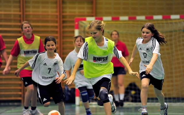 HAMBURG, GERMANY - FEBRUARY 05:  Action from handball game involving girls from local teams and Olympic athlets at an event where children meet Olympic competitors at the Hamburg Mannheimer headquarters on February 5, 2009 in Hamburg, Germany.  (Photo by Stuart Franklin/Bongarts/Getty Images)