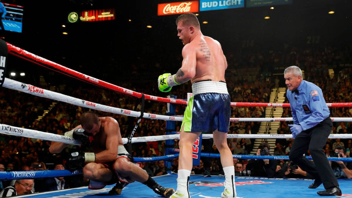 LAS VEGAS, NEVADA - NOVEMBER 02: Canelo Alvarez (C) knocks out Sergey Kovalev in the 11th round of their WBO light heavyweight fight as referee Russell Mora looks on at MGM Grand Garden Arena on November 02, 2019 in Las Vegas, Nevada. (Photo by Steve Marcus/Getty Images)