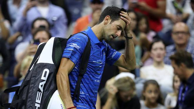NEW YORK, NEW YORK - SEPTEMBER 01: Novak Djokovic of Serbia reacts as he walks off court after retiring due to a shoulder injury during his Men's Singles fourth round match against Stan Wawrinka of Switzerland on day seven of the 2019 US Open at the USTA Billie Jean King National Tennis Center on September 01, 2019 in Queens borough of New York City. (Photo by Matthew Stockman/Getty Images)