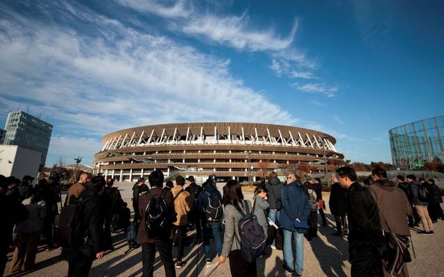 Journalists visit the National Stadium, venue for the upcoming Tokyo 2020 Olympic Games, during a media tour following the stadium's completion in Tokyo on December 15, 2019. - The Tokyo 2020 Olympics organisers on December 15 celebrated the completion of the main stadium that features use of lumber and other Japanese architectural tradition, seven months before the Opening Ceremony. (Photo by Behrouz MEHRI / AFP) (Photo by BEHROUZ MEHRI/AFP via Getty Images)