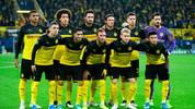 (Back row, From L) Dortmund's Swiss defender Manuel Akanji, Dortmund's Belgian midfielder Axel Witsel, Dortmund's German defender Mats Hummels, Dortmund's German defender Nico Schulz, Dortmund's German midfielder Julian Weigl and Dortmund's Swiss goalkeeper Roman Buerki (Front row, From L) Dortmund's Belgian forward Thorgan Hazard, Dortmund's Moroccan defender Achraf Hakimi, Dortmund's German forward Marco Reus, Dortmund's German forward Julian Brandt and Dortmund's English midfielder Jadon Sancho pose for the team photo prior to the UEFA Champions League Group F football match BVB Borussia Dortmund v Inter Milan in Dortmund, western Germany, on November 5, 2019. (Photo by INA FASSBENDER / AFP) (Photo by INA FASSBENDER/AFP via Getty Images)