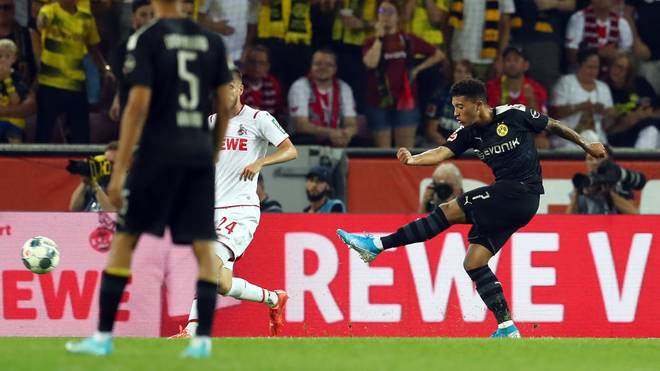 COLOGNE, GERMANY - AUGUST 23:  Jadon Sancho of Borussia Dortmund scores his side's first goal during the Bundesliga match between 1. FC Koeln and Borussia Dortmund at RheinEnergieStadion on August 23, 2019 in Cologne, Germany. (Photo by Lars Baron/Bongarts/Getty Images)