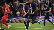 TOPSHOT - Paris Saint-Germain's French forward Kylian Mbappe celebrates after scoring the 2-0 goal during the French L1 football match between Paris Saint-Germain (PSG) and Nimes Olympique on August 11, 2019 at the Parc des Princes stadium in Paris. (Photo by FRANCK FIFE / AFP)        (Photo credit should read FRANCK FIFE/AFP/Getty Images)