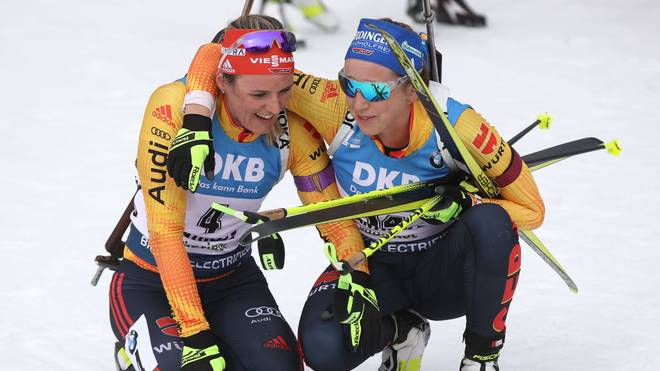 ANTHOLZ-ANTERSELVA, ITALY - FEBRUARY 23: Dennise Herrmann of Germany (L) reacts with her team mate Franziska Preuss (R) at the finish area after the Women 12.5 km Mass Start Competition at the IBU World Championships Biathlon Antholz-Anterselva on February 23, 2020 in Antholz-Anterselva, Italy. (Photo by Alexander Hassenstein/Bongarts/Getty Images)