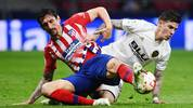 Atletico Madrid's Montenegrin defender Stefan Savic (L) vies with Valencia's Spanish forward Santi Mina during the Spanish league football match between Club Atletico de Madrid and Valencia CF at the Wanda Metropolitano stadium in Madrid on April 24, 2019. (Photo by GABRIEL BOUYS / AFP)        (Photo credit should read GABRIEL BOUYS/AFP/Getty Images)