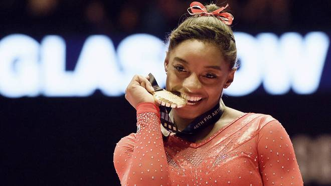 Gymnastics: Simone Biles Photo taken Oct. 29, 2015, shows Simone Biles of the United States biting her gold medal after winning the women s individual all-around at the world gymnastics championships in Glasgow, Scotland. PUBLICATIONxINxGERxSUIxAUTxHUNxONLY