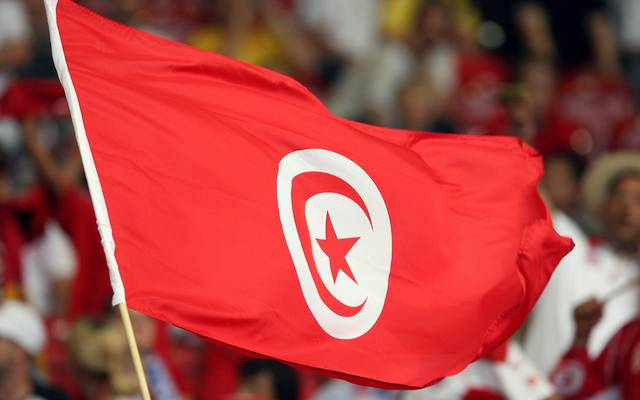The Tunisian flag is waves by supporters