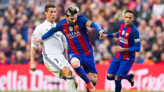 Eine Universität in Belgien sagt, dass Lionel Messi (m.) etwa doppelt so gut ist wie Cristiano Ronaldo (l.)