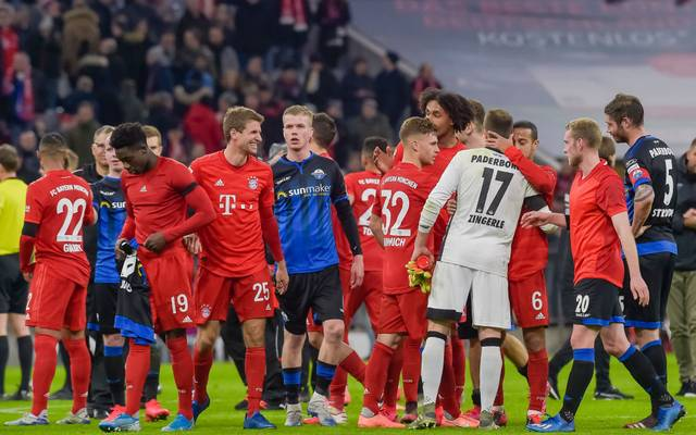 Players react after the German first division Bundesliga football match FC Bayern Munich v SC Paderborn in Munich, southern Germany, on February 21, 2020. (Photo by Guenter SCHIFFMANN / AFP) / RESTRICTIONS: DFL REGULATIONS PROHIBIT ANY USE OF PHOTOGRAPHS AS IMAGE SEQUENCES AND/OR QUASI-VIDEO (Photo by GUENTER SCHIFFMANN/AFP via Getty Images)