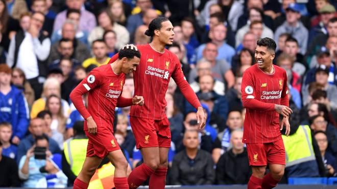 Haben gut lachen: Alexander-Arnold (l.) und Roberto Firmino (r.) treffen bei Liverpools Auswärtssieg gegen Chelsea