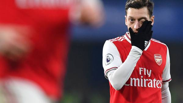 Arsenal's German midfielder Mesut Ozil reacts during the English Premier League football match between Chelsea and Arsenal at Stamford Bridge in London on January 21, 2020. (Photo by Ben STANSALL / AFP) / RESTRICTED TO EDITORIAL USE. No use with unauthorized audio, video, data, fixture lists, club/league logos or 'live' services. Online in-match use limited to 120 images. An additional 40 images may be used in extra time. No video emulation. Social media in-match use limited to 120 images. An additional 40 images may be used in extra time. No use in betting publications, games or single club/league/player publications. /  (Photo by BEN STANSALL/AFP via Getty Images)