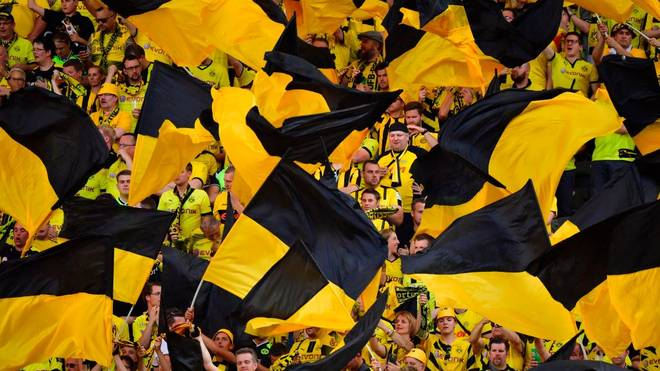 Dortmund's fans wave flags ahead the German Cup (DFB Pokal) final football match Eintracht Frankfurt v BVB Borussia Dortmund at the Olympic stadium in Berlin on May 27, 2017. / AFP PHOTO / John MACDOUGALL / RESTRICTIONS: ACCORDING TO DFB RULES IMAGE SEQUENCES TO SIMULATE VIDEO IS NOT ALLOWED DURING MATCH TIME. MOBILE (MMS) USE IS NOT ALLOWED DURING AND FOR FURTHER TWO HOURS AFTER THE MATCH. == RESTRICTED TO EDITORIAL USE == FOR MORE INFORMATION CONTACT DFB DIRECTLY AT +49 69 67880 /         (Photo credit should read JOHN MACDOUGALL/AFP via Getty Images)