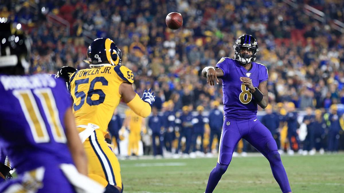 Quarterback Lamar Jackson #8 of the Baltimore Ravens delivers a pass against the Los Angeles Rams