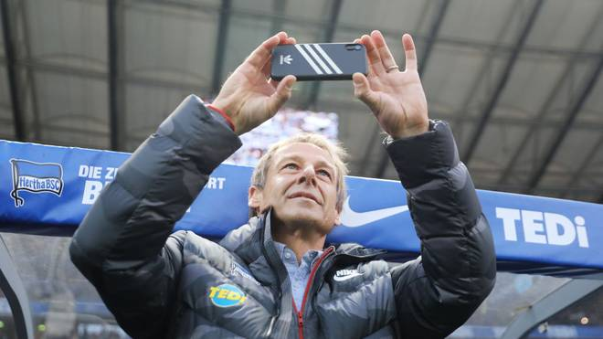 BERLIN, GERMANY - NOVEMBER 30: Jurgen Klinsmann, Head Coach of Hertha BSC takes a photograph prior to the Bundesliga match between Hertha BSC and Borussia Dortmund at Olympiastadion on November 30, 2019 in Berlin, Germany. (Photo by Boris Streubel/Bongarts/Getty Images)