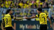 Dortmund's Spanish forward Paco Alcacer (L) and Dortmund's English midfielder Jadon Sancho react during the German first division Bundesliga football match Borussia Dortmund v VfL Wolfsburg on March 30, 2019 in Dortmund. (Photo by SASCHA SCHUERMANN / AFP) / RESTRICTIONS: DFL REGULATIONS PROHIBIT ANY USE OF PHOTOGRAPHS AS IMAGE SEQUENCES AND/OR QUASI-VIDEO        (Photo credit should read SASCHA SCHUERMANN/AFP via Getty Images)