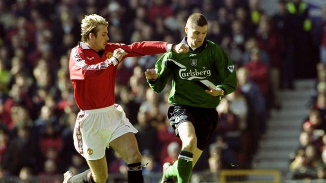 4 Mar 2000:  Dominic Matteo of Liverpool takes on David Beckham of Manchester United during the FA Carling Premiership match at Old Trafford in Manchester, England. The game ended 1-1. \ Mandatory Credit: Clive Brunskill /Allsport