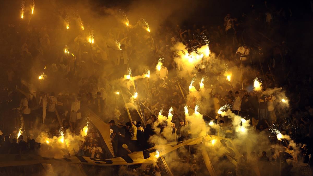 Supporters of Boca Juniors light flares