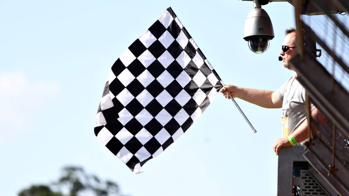 SAO PAULO, BRAZIL - NOVEMBER 16: The chequered flag is waved during qualifying for the F1 Grand Prix of Brazil at Autodromo Jose Carlos Pace on November 16, 2019 in Sao Paulo, Brazil. (Photo by Mark Thompson/Getty Images)