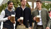 (L-R) Bayern Munich's German midfielder Serge Gnabry, Bayern Munich's German midfielder Leon Goretzka and Bayern Munich's French defender Benjamin Pavard wear traditional Bavarian Lederhosen (leather trousers) dresses as they pose during their football club's annual visit at the Oktoberfest beer festival in Munich, southern Germany, on October 6, 2019. (Photo by Christof STACHE / AFP) (Photo by CHRISTOF STACHE/AFP via Getty Images)