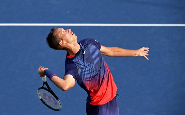 NEW YORK, NEW YORK - AUGUST 26: Philipp Kohlschreiber of Germany serves during his men's singles first round match against Lucas Pouille of France during day one of the 2019 US Open at the USTA Billie Jean King National Tennis Center on August 26, 2019 in the Flushing neighborhood of the Queens borough of New York City.  (Photo by Emilee Chinn/Getty Images)