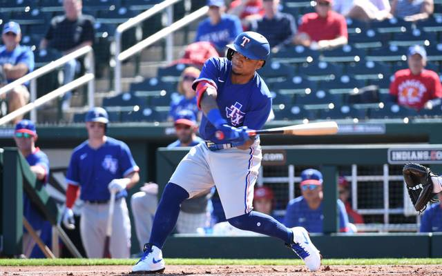 GOODYEAR, ARIZONA - FEBRUARY 24: Willie Calhoun #5 of the Texas Rangers swings at a pitch during the first inning of a spring training game against the Cincinnati Reds at Goodyear Ballpark on February 24, 2020 in Goodyear, Arizona. (Photo by Norm Hall/Getty Images)