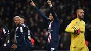 Paris Saint-Germain's French forward Kylian Mbappe (C) celebrates after scoring a goal during the French League cup final quarter match between Paris Saint-Germain (PSG) and AS Saint Etienne at the Parc des Princes stadium in Paris on January 8, 2020. (Photo by Anne-Christine POUJOULAT / AFP) (Photo by ANNE-CHRISTINE POUJOULAT/AFP via Getty Images)