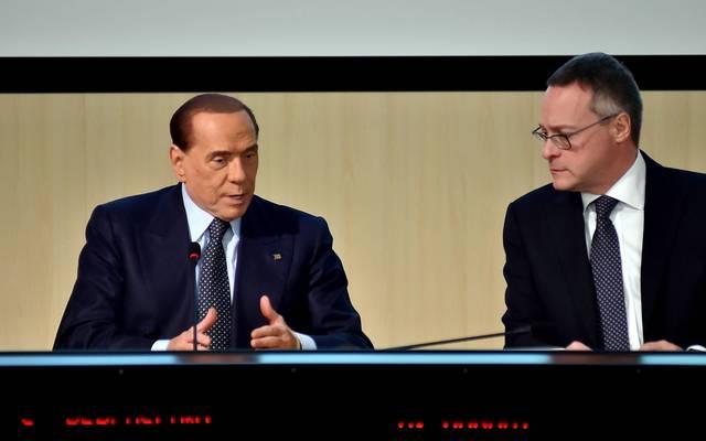 Silvio Berlusconi (l.) ist positiv auf COVID-19 getestet worden