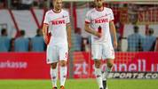 COLOGNE, GERMANY - AUGUST 13: Simon Terodde of Cologne (L) and Lasse Sobiech leave the pitch after the Second Bundesliga match between 1. FC Koeln and 1. FC Union Berlin at RheinEnergieStadion on August 13, 2018 in Cologne, Germany. (Photo by Juergen Schwarz/Bongarts/Getty Images)