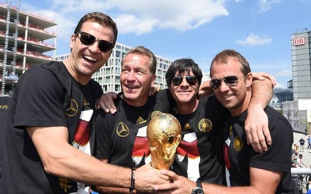 Oliver Bierhoff, Andreas Köpke, Joachim Löw und Hansi Flick (v.l.) bejubeln den WM-Titel 2014
