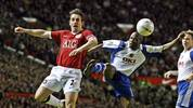 Manchester United's Gary Neville (L) vies with   Portsmouth's Bisan Lauren  during their FA Cup fourth round football match at Old Trafford , Manchester, North-west  England, 27 January , 2007. AFP PHOTO/ANDREW YATES (Photo by Andrew YATES / AFP) (Photo by ANDREW YATES/AFP via Getty Images)