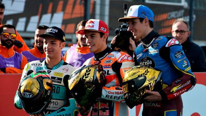 MotoGP world champion Repsol Honda Team's Spanish rider Marc Marquez (C) poses with Moto2 world champion EG 0,0 Marc VDS's Spanish rider Alex Marquez (L) and Moto3 world champion Leopard Racing's Italian rider Lorenzo Dalla Porta before the MotoGP race of the Valencia Grand Prix at the Ricardo Tormo racetrack in Cheste near Valencia, on November 17, 2019. -  (Photo by JOSE JORDAN / STR / AFP) (Photo by JOSE JORDAN/STR/AFP via Getty Images)