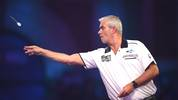 LONDON, ENGLAND - DECEMBER 19: Steve Beaton in action during the round 2 match between  Kyle Anderson and Steve Beaton on Day 7 of the 2020 William Hill World Darts Championship at Alexandra Palace on December 19, 2019 in London, England. (Photo by Alex Davidson/Getty Images)