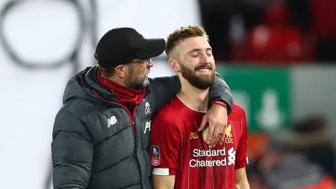 LIVERPOOL, ENGLAND - JANUARY 05: Jurgen Klopp, Manager of Liverpool speaks to Nathaniel Phillips of Liverpool after the FA Cup Third Round match between Liverpool and Everton at Anfield on January 05, 2020 in Liverpool, England. (Photo by Clive Brunskill/Getty Images)