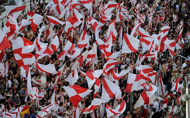 MADRID, SPAIN - OCTOBER 04:  Rayo Vallecano de Madrid fans wave their red and white striped flags the the Campo de Futbol de Vallecas stadium during the La Liga match between Rayo Vallecano de Madrid and FC Barcelona on October 4, 2014 in Madrid, Spain.  (Photo by Denis Doyle/FC Barcelona via Getty Images)