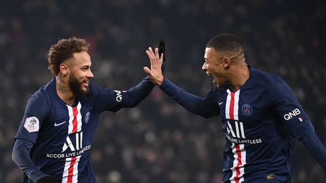 TOPSHOT - Paris Saint-Germain's Brazilian forward Neymar (L) is congratulated by Paris Saint-Germain's French forward Kylian Mbappe after scoring his team's first goal during the French L1 football match between Paris Saint-Germain (PSG) and FC Nantes (FCN) at the Parc des Princes in Paris, on December 4, 2019. (Photo by FRANCK FIFE / AFP) (Photo by FRANCK FIFE/AFP via Getty Images)